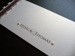 Century Gothic font on a cheque book wedding invitation