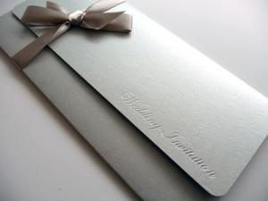 Silver foiled wedding invitation