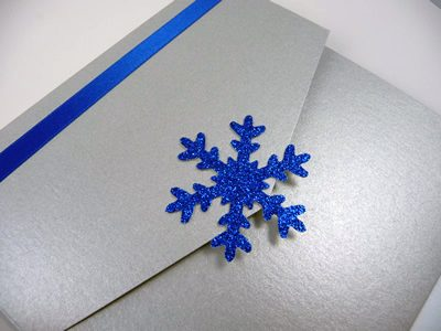Silver portrait pocketfold invitation with a royal blue colour scheme and snowflake theme