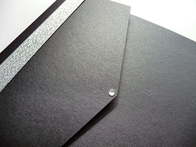 Black landscape pocketfold with silver ribbon and a round diamante