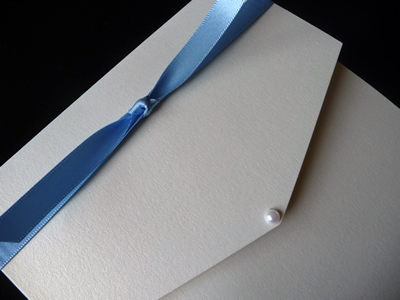 Ivory portrait pocketfold with cornflower blue knotted ribbon detail