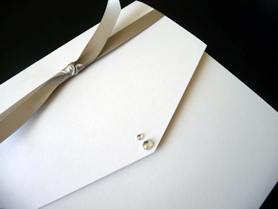 Ivory portrait pocketfold with taupe knotted ribbon detail