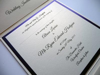Ivory portrait pocketfold with a purple colour scheme