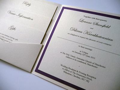 Ivory and purple pocketcard wedding invitation with horizontal ribbon