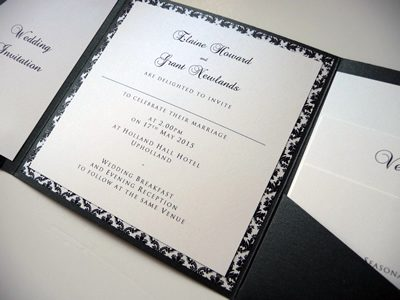 Black and White landscape pocketfold wedding invitation with a damask patterned paper inlay