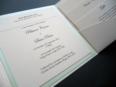 Ivory landscape pocketfold with mint green ribbon and ivory lace