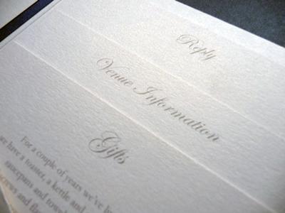 Ivory landscape pocketfold invitation with a charcoal colour scheme
