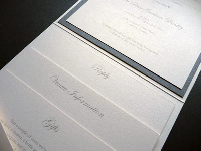Ivory portrait pocketfold invitation with ivory lace and charcoal ribbon