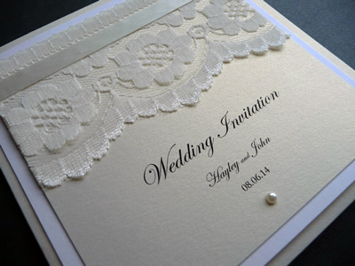 Ivory and silver pocketcard with lace and a silver colour scheme