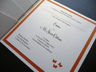 Ivory pocketcard wedding invitation with an orange colour scheme and a butterfly theme