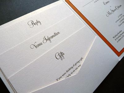 Ivory pocketcard wedding invitation with an orange colour scheme