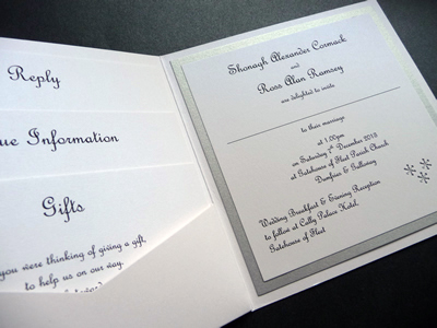 Silver and white pocketcard wedding invitation with a snowflake theme