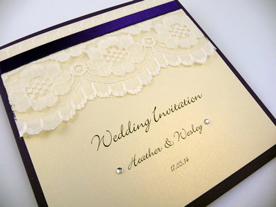 Navy and ivory pocketcard wedding invitation with lace and navy ribbon detailing