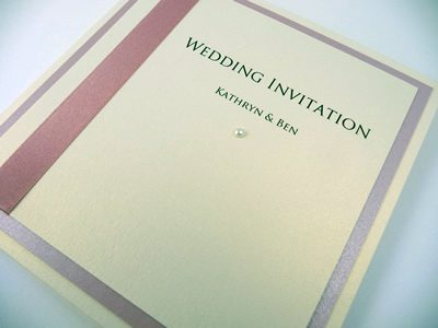 Ivory and dusky pink pocketcard wedding invitation with vertical ribbon