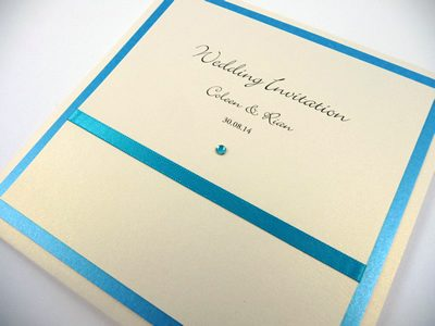 Ivory and turquoise pocketcard wedding invitation with flat ribbon