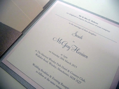 Silver pocketcard wedding invitation with a pink colour scheme