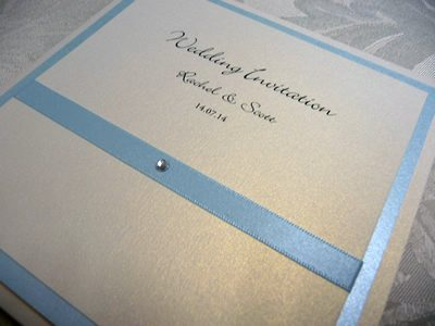 Cornflower blue and ivory pocketcard wedding invitation with flat ribbon