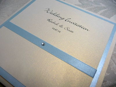 Cornflower blue and ivory pocketcard wedding invitation with flat ribbon