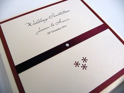 Red and ivory pocketcard wedding invitation with a snowflake theme