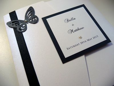 White and Black pocketfold with a plaque and butterfly theme