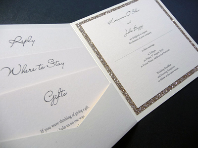 Ivory pocketcard wedding invitation with a champagne gold glitter mount