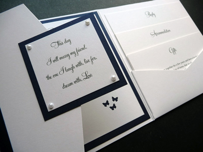 White landscape pocketfold wedding invitation with a plaque and butterfly theme