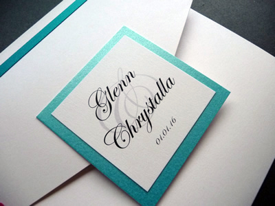 White portrait pocketfold wedding invitation with a turquoise colour scheme and plaque