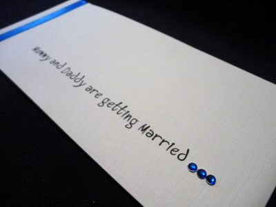 Royal blue and ivory cheque book with mummy and daddy wording
