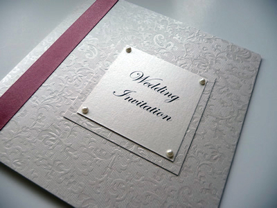 Textured pink folded card with flat ribbon and a double mounted plaque