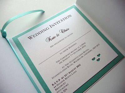 White and aqua gate fold invitation with a heart theme inside