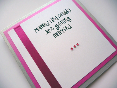 Silver and Pink folded invitation with mummy and daddy are getting married wording on the cover