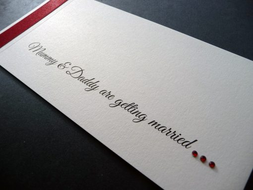 Red and ivory cheque book with mummy and daddy wording