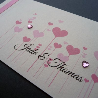 Pink and ivory cheque book with a pretty heart detail and diamantes