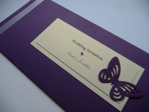 Purple and ivory cheque book with a plaque and butterfly theme