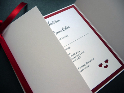 Red and white gate fold wedding invitation with a heart theme inside