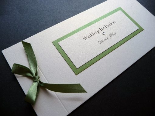 Sage green and ivory cheque book with a bow and plaque detail