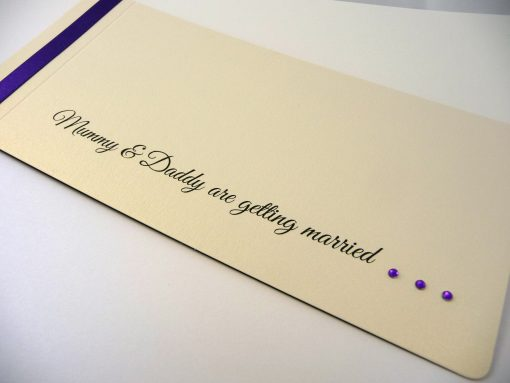Purple and ivory cheque book with mummy and daddy wording