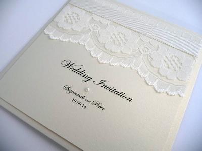 Ivory folded wedding invitation with lace