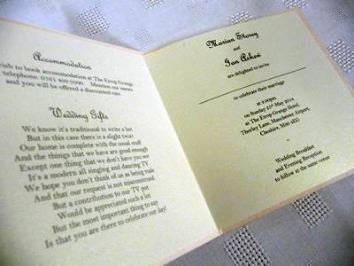 Folded paper insert with guest information printed to the left side