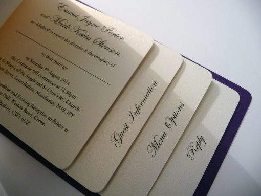 Ivory cheque book with a purple back cover and 4 insert pages