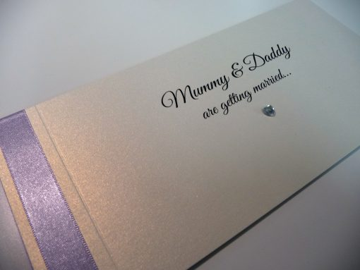 Lilac and ivory cheque book invitation with mummy and daddy are getting married wording