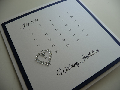 White pocketcard wedding invitation with a calendar themed cover