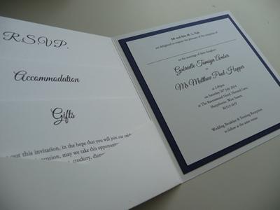 White pocketcard wedding invitation with a calendar themed cover