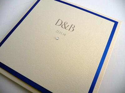 Ivory pocketcard wedding invitation with a royal blue colour scheme with initials on the cover