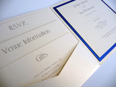Ivory pocketcard wedding invitation with a royal blue colour scheme with 3 loose inserts