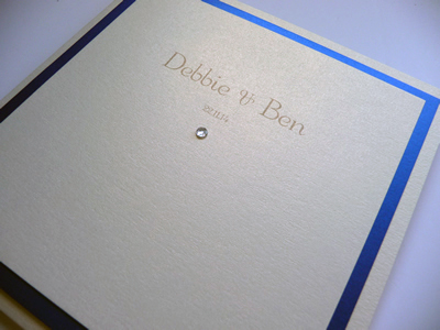 Ivory pocketcard wedding invitation with a royal blue colour scheme without ribbon