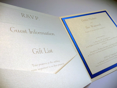 Ivory pocketcard wedding invitation with a royal blue colour scheme and 3 loose inserts