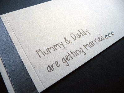 Charcoal and ivory cheque book invitation with mummy and daddy are getting married wording
