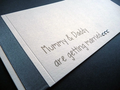 Charcoal and ivory cheque book invitation with mummy and daddy are getting married wording and diamantes