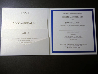 Ivory pocketcard wedding invitation with a royal blue colour scheme and no ribbon